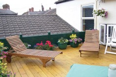 Classic Green gravel boards used around a sun deck.